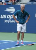 Seven times Grand Slam Champion John McEnroe in action during 2018 US Open exhibition match at newly open Louis Armstrong Stadium. NEW YORK - AUGUST 22, 2018 stock images