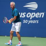 Seven times Grand Slam Champion John McEnroe in action during 2018 US Open exhibition match at newly open Louis Armstrong Stadium. NEW YORK - AUGUST 22, 2018 stock photos