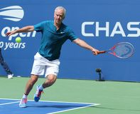 Seven times Grand Slam Champion John McEnroe in action during 2018 US Open exhibition match at newly open Louis Armstrong Stadium. NEW YORK - AUGUST 22, 2018 royalty free stock photos