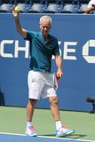 Seven times Grand Slam Champion John McEnroe in action during 2018 US Open exhibition match at newly open Louis Armstrong Stadium. NEW YORK - AUGUST 22, 2018 stock photography