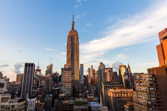 NEW YORK - AUGUST 23, 2015. NEW YORK - AUGUST 23: View to Midtown Manhattan with the famous Empire State Building at sunset on August 23, 2015. This view is from Stock Photography