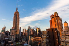 NEW YORK - AUGUST 23, 2015. NEW YORK - AUGUST 23: View to Midtown Manhattan with the famous Empire State Building at sunset on August 23, 2015. This view is from Royalty Free Stock Images