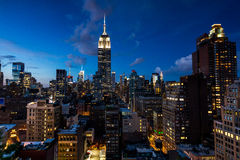 NEW YORK - AUGUST 23, 2015. NEW YORK - AUGUST 23: View to Midtown Manhattan with the famous Empire State Building at sunset on August 23, 2015. This view is from Royalty Free Stock Photography