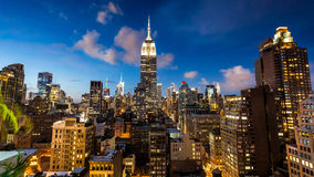 NEW YORK - AUGUST 23, 2015. NEW YORK - AUGUST 23: View to Midtown Manhattan with the famous Empire State Building at sunset on August 23, 2015. This view is from Stock Photo