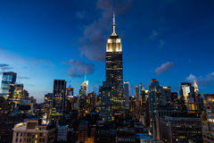 NEW YORK - AUGUST 23, 2015. NEW YORK - AUGUST 23: View to Midtown Manhattan with the famous Empire State Building at sunset on August 23, 2015. This view is from Stock Images