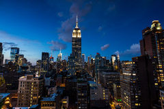 NEW YORK - AUGUST 24, 2015. NEW YORK - AUGUST 23: View to Midtown Manhattan with the famous Empire State Building at sunset on August 23, 2015. This view is from Royalty Free Stock Photo