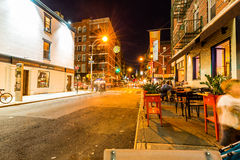 NEW YORK - AUGUST 22. View to the Mulberry Street at night in New York on August 22, 2015. The Mulberry Street is in the district called Little Italy Royalty Free Stock Image