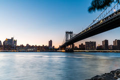 NEW YORK - AUGUST 22. Views of the Manhattan Bridge on  sunset on August 22, 2015. Its a famous and iconic bridge in New York, which passes the east river Stock Images