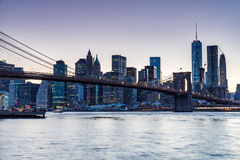 NEW YORK - AUGUST 22. Views of the Brooklyn Bridge on sunset on August 22, 2015. Its a famous and iconic bridge in New York, which passes the east river Royalty Free Stock Images