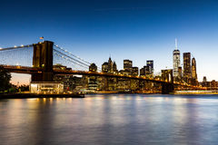 NEW YORK - AUGUST 22. Views of the Brooklyn Bridge on sunset on August 22, 2015. Its a famous and iconic bridge in New York, which passes the east river Royalty Free Stock Photo