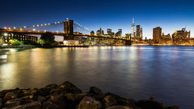 NEW YORK - AUGUST 22. Views of the Brooklyn Bridge on sunset on August 22, 2015. Its a famous and iconic bridge in New York, which passes the east river Stock Photography