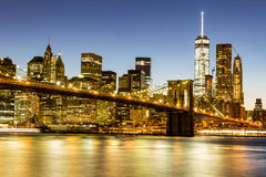 NEW YORK - AUGUST 22. Views of the Brooklyn Bridge on sunset on August 22, 2015. Its a famous and iconic bridge in New York, which passes the east river Stock Image