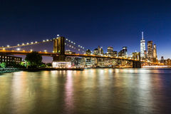 NEW YORK - AUGUST 22. Views of the Brooklyn Bridge on sunset on August 22, 2015. Its a famous and iconic bridge in New York, which passes the east river Stock Images