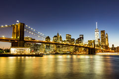 NEW YORK - AUGUST 22. Views of the Brooklyn Bridge on sunset on August 22, 2015. Its a famous and iconic bridge in New York, which passes the east river Royalty Free Stock Photos