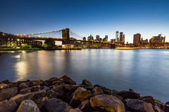 NEW YORK - AUGUST 22, 2015. NEW YORK - AUGUST 22: Views of the Brooklyn Bridge on sunset on August 22, 2015. Its a famous and iconic bridge in New York, which Royalty Free Stock Photography