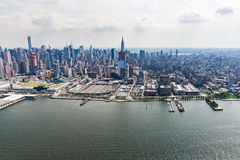 NEW YORK - AUGUST 24, 2015. NEW YORK - AUGUST 24: Views of Midtown Manhattan from a helicopter in New York on August 24, 2015. Helicopter tours are popular by Royalty Free Stock Images