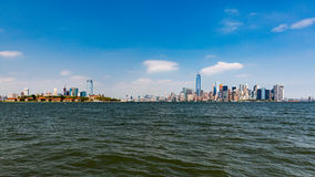 NEW YORK - AUGUST 24, 2015. NEW YORK - AUGUST 24: Views of Midtown Manhattan from Liberty Island side on August 24, 2015. This park provides a beautiful view to Royalty Free Stock Photos