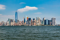 NEW YORK - AUGUST 24, 2015. NEW YORK - AUGUST 24: Views of Midtown Manhattan from Liberty Island side on August 24, 2015. This park provides a beautiful view to Stock Photos