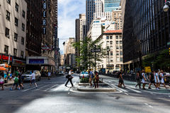 NEW YORK - AUGUST 22. Views of the rush streets of Manhattan at 7th Avenue on August 22, 2015. Its on the intersection of W53 Street near the Times Square Royalty Free Stock Photo