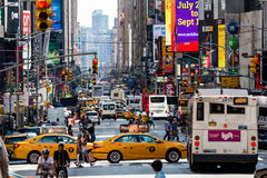 NEW YORK - AUGUST 22. Views of the rush streets of Manhattan at 7th Avenue on August 22, 2015. Its on the intersection of W53 Street near the Times Square Royalty Free Stock Photos