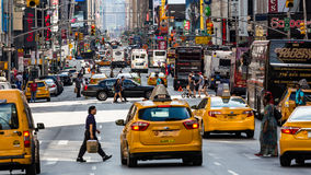 NEW YORK - AUGUST 22. Views of the rush streets of Manhattan at 7th Avenue on August 22, 2015. Its on the intersection of W53 Street near the Times Square Stock Photo