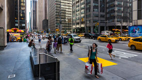 NEW YORK - AUGUST 23, 2015. NEW YORK - AUGUST 22: Views of the rush streets of Manhattan at 7th Avenue on August 22, 2015. Its on the intersection of W53 Street Royalty Free Stock Photography