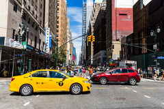 NEW YORK - AUGUST 22. Views of the rush streets of Manhattan at Times Square on August 22, 2015. Times Square is a busy place in the Midtown district of Stock Photos