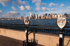 New York binoculars. Classic binoculars or telescopes at New Jersey central station, afternoon view of Hudson river and New York's Manhattan is seen in Royalty Free Stock Images