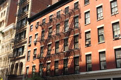 New York brick buildings with outside fire escape stairs Royalty Free Stock Images