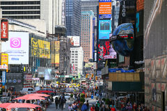 New York - Broadway. New York City, USA - May 19, 2014: The pedestrian zone of the broadway in the New York City Theater District with musical theaters and shops Royalty Free Stock Photo