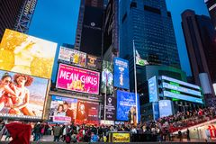 New York, Broadway at night. Colorful large billboards and crowd waiting for the shows. USA, New York, Manhattan. May 3, 2019. Times square at night. Colorful stock photos
