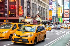 New York, Broadway streets. High buildings, colorful neon lights, ads and cars. USA, New York, Times square. May 3, 2019. Broadway streets. High buildings royalty free stock photography