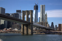 New York - Brooklyn bridge. An amazing view of the Brooklyn bridge with the Financial District and the Millenium Tower in the background Stock Image