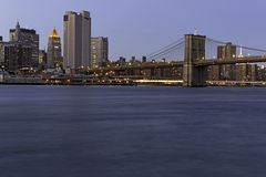 New York. Brooklyn Bridge and East River at night Royalty Free Stock Photography