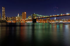New York. Brooklyn Bridge and East River at night royalty free stock images
