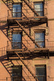 New york building facade, USA. A typical New Yorker building facade with its fire escape, NY, USA Stock Image