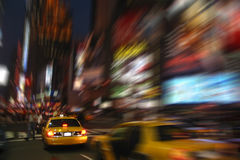New York cab at Times Square by night. NY cab at times square in motion stock image