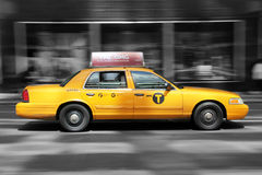 New York Cab. Typical yellow New York taxi rushing their passenger through the bustling city Stock Photo