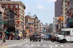 New York Chinatown. NEW YORK, USA - JULY 2, 2013: People visit Chinatown in New York. NYC Chinatown has an estimated population of 100,000 people and is one of stock photos