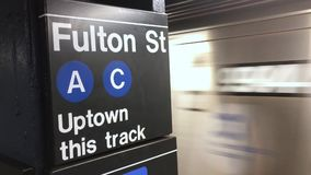 Subway Train Arrives at Fulton Street Station. NEW YORK - Circa August, 2016 - An uptown subway train approaches the Fulton Street A-C platform. With audio stock footage