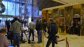 Media camped out inside lobby of Trump Tower stock footage