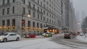 Wintry establishing shot Plaza Hotel and traffic on Central Park South. New York - circa December, 2016 - A wintry establishing shot of the side entrance of the stock footage