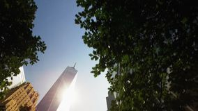 Looking Straight Up at World Trade Center Buildings and Freedom Tower. NEW YORK - Circa July, 2016 - Looking up at the Freedom Tower as seen from the Hudson stock video footage