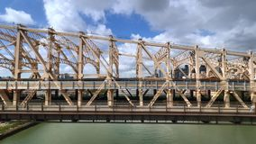 Side View of the Ed Koch Queensboro Bridge as Seen from the Roosevelt Tramway. NEW YORK - Circa July, 2016 - A unique aerial side view of traffic on the Ed Koch stock video