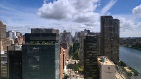 Aerial View of East River from Roosevelt Island Tramway. NEW YORK - Circa July, 2016 - A unique aerial view of buildings on York Avenue in Manhattan as seen from stock video