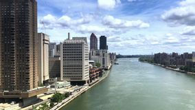 Aerial View of East River from Roosevelt Island Tramway PT1of2. NEW YORK - Circa July, 2016 - A unique aerial view of the East River as seen from the Roosevelt stock video footage