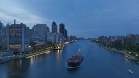 Evening Aerial View of East River from Roosevelt Island Tramway. NEW YORK - Circa July, 2016 - A unique evening aerial view of the East River as seen from the stock video