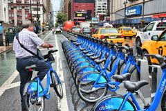 New York Citibike. NEW YORK, USA - JULY 1, 2013: Man uses Citibike bicycle sharing station in New York. With 330 stations and 6,000 bicycles it is one of top 10 Stock Images