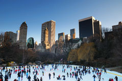 New York City. Central Park Ice Skate, New York City with skyscrapers Stock Images