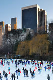 New York City. Central Park Ice Skate, New York City with skyscrapers Royalty Free Stock Photography